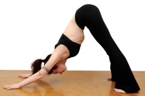 girl in downward facing dog yoga pose