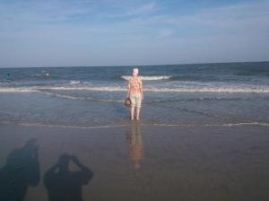 Carrie standing in the surf